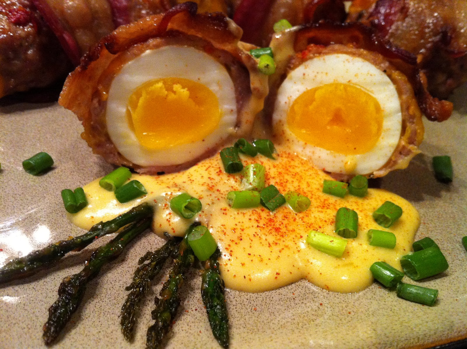 Bacon Wrapped Scotch Eggs With Hollandaise And Asparagus